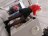 Candid lady in black pantyhose working in a store