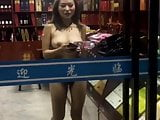asian exhibitionist nude in shop